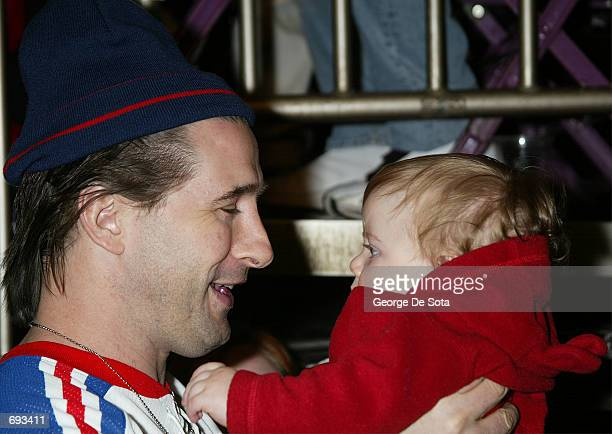 Actor Billy Baldwin is handed a young child as he attends the 4th Annual SuperSkate 2002 Charity Hockey Event January 19 2002 at Madison Square...
