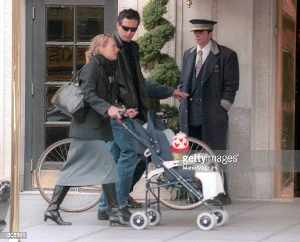 Actor Billy Baldwin strolls with his wife and child November 7 2000 on the Westside of New York City