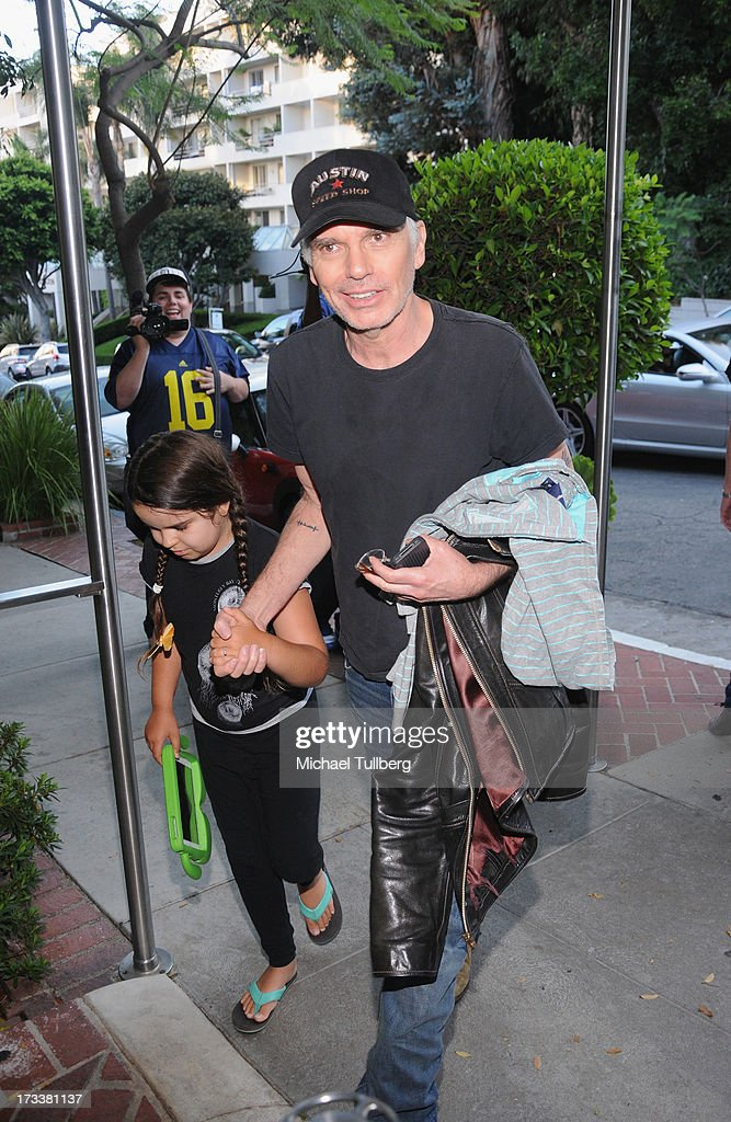 Actor Billy Bob Thornton and daugher Bella arrive during the opening of musician Dave Stewart's photography exhibition 'Dave Stewart: Jumpin' Jack Flash & The Suicide Blonde' at Morrison Hotel Gallery on July 12, 2013 in West Hollywood, California.