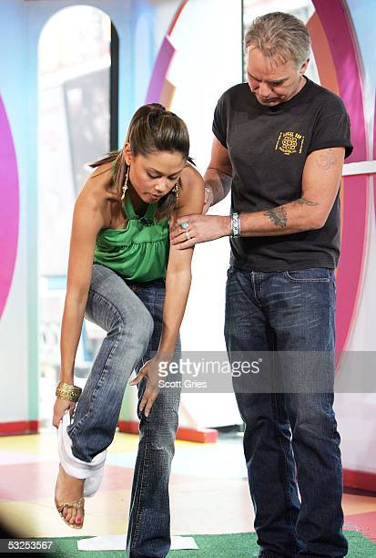 Actor Billy Bob Thornton helps VJ Vanessa Minnillo put on a jock strap during MTV's Total Request Live at the MTV Times Square Studios July 18 2005...