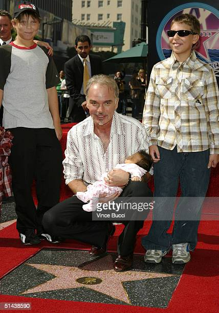 Actor Billy Bob Thornton holds newborn daughter Bella while posing with sons William and Harry at the ceremony honoring him with a star on the...