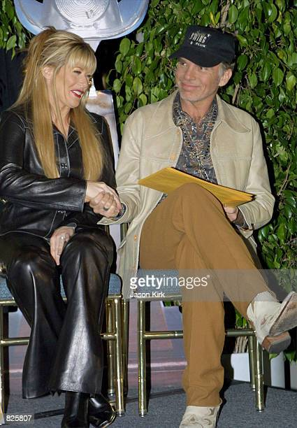 Actor Billy Bob Thornton shakes hands with country singer and nominee Jamie O''Neal at the press conference to announce the nominations for the 36th...