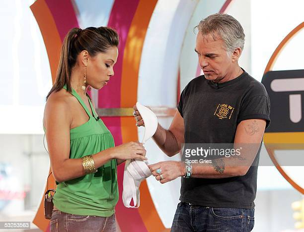 Actor Billy Bob Thornton shows VJ Vanessa Minnillo how to use a jock strap during MTV's Total Request Live at the MTV Times Square Studios July 18...