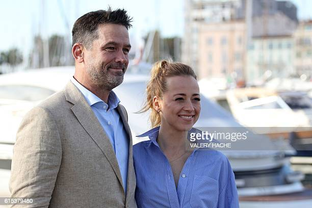 US actor Billy Campbell and Canadian actress Karine Vanasse pose during a photocall for the TV series Cardinal as part of the MIPCOM on October 18...