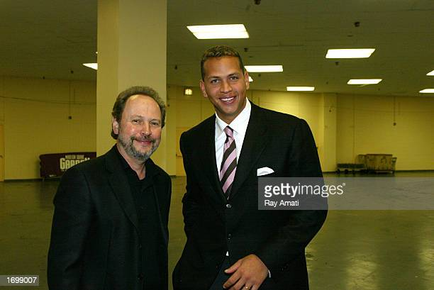 Actor Billy Crystal and Alex Rodriguez of the Texas Rangers pose for a picture during a break in the action between the Miami Heat and the New York...