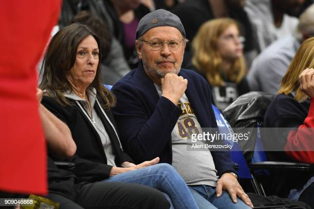 Actor Billy Crystal and Janice Crystal attend a basketball game between the Los Angeles Clippers and the Minnesota Timberwolves at Staples Center on...