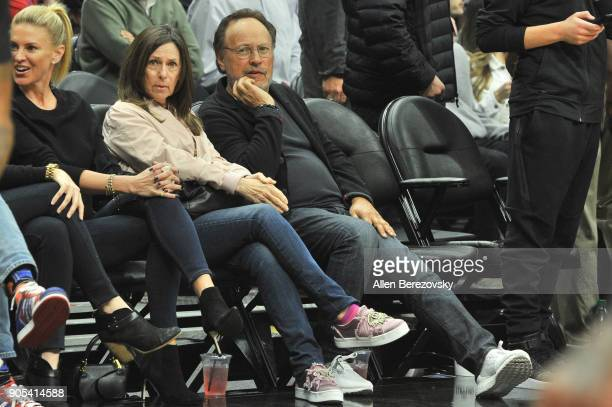 Actor Billy Crystal and wife Janice Crystal attend a basketball game between the Los Angeles Clippers and the Houston Rockets at Staples Center on...