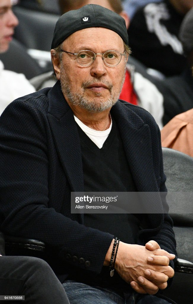 Actor Billy Crystal attends a basketball game between the Los Angeles Clippers and the San Antonio Spurs at Staples Center on April 3, 2018 in Los Angeles, California.