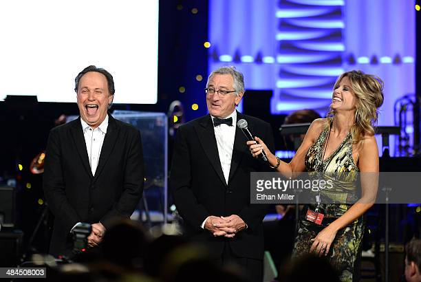 Actor Billy Crystal honoree Robert De Niro and television personality Tara Hitchcock speak onstage during Muhammad Ali's Celebrity Fight Night XX...