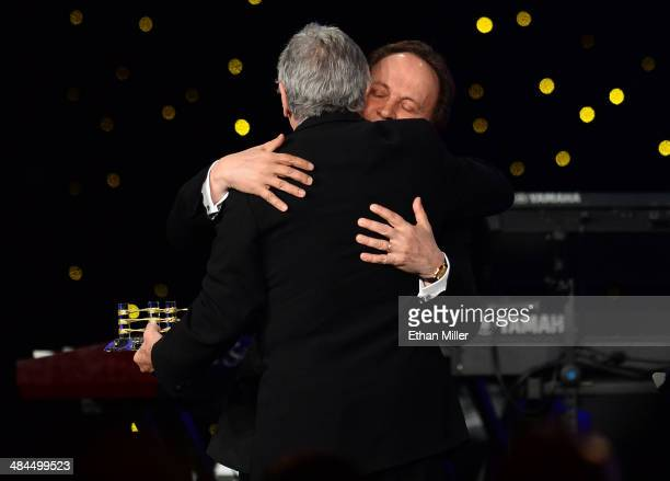 Actor Billy Crystal presents honoree Robert De Niro with an award onstage during Muhammad Ali's Celebrity Fight Night XX held at the JW Marriott...