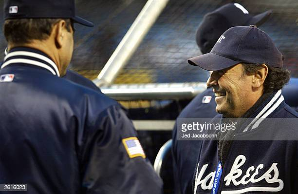 f519327f40f Actor Billy Crystal talks with New York Yankee manager Joe Torre prior to  game 2 of