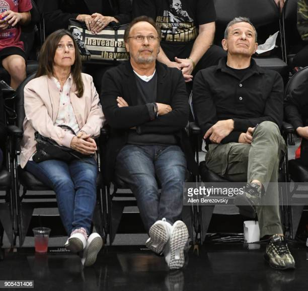 Actor Billy Crystal wife Janice Crystal and Bob Iger attend a basketball game between the Los Angeles Clippers and the Houston Rockets at Staples...