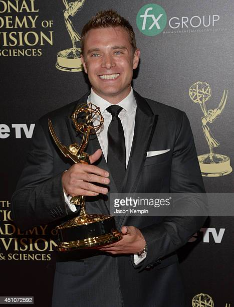 """Actor Billy Miller poses in the press room with the Outstanding Lead Actor in a Drama Series award for """"The Young and the Restless"""" during The 41st..."""