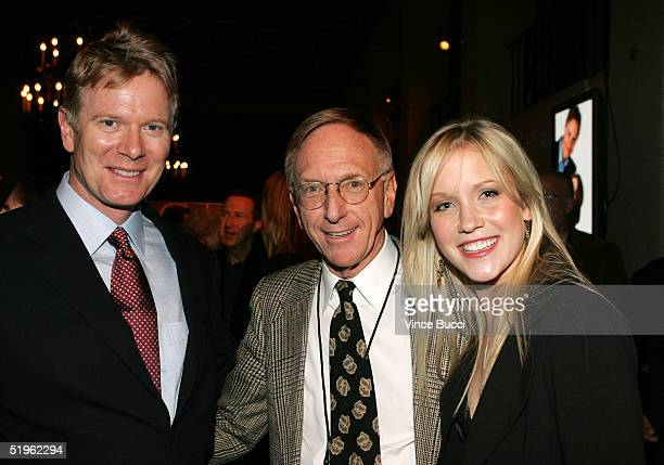 Actor Billy Moses and actress Jessy Schram pose with Hallmark Channel executive David Kenin at the Hallmark Channel's TCA Press Tour party on January...