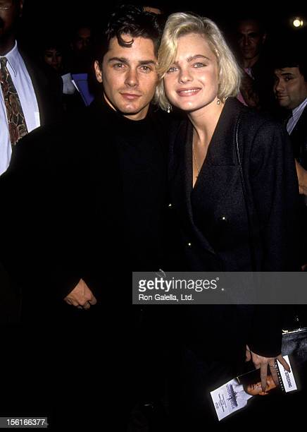 Actor Billy Warlock and actress Erika Eleniak attend the premiere of 'Under Siege' on October 8 1992 at Mann Village Theater in Westwood California