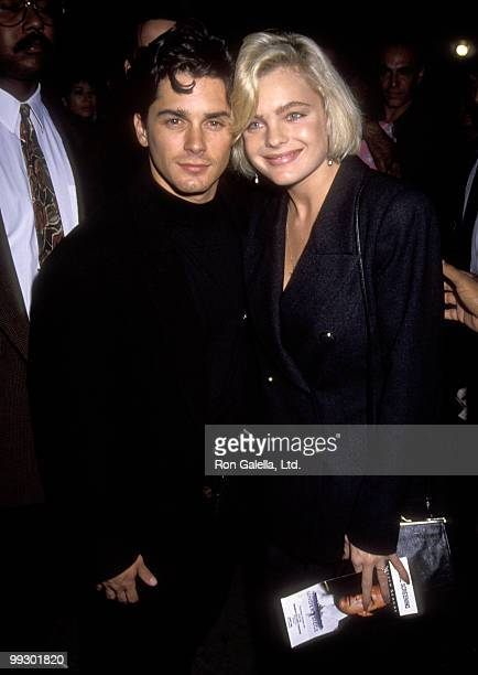 Actor Billy Warlock and actress Erika Eleniak attend the premiere of Under Siege on October 8 1992 at Mann Village Theater in Westwood California