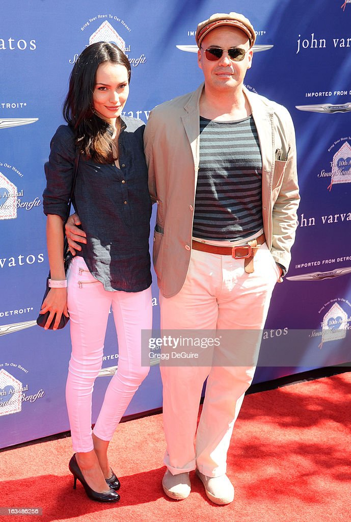 Actor Billy Zane (R) and Candice Neill arrive at John Varvatos 10th Annual Stuart House Benefit at John Varvatos Los Angeles on March 10, 2013 in Los Angeles, California.