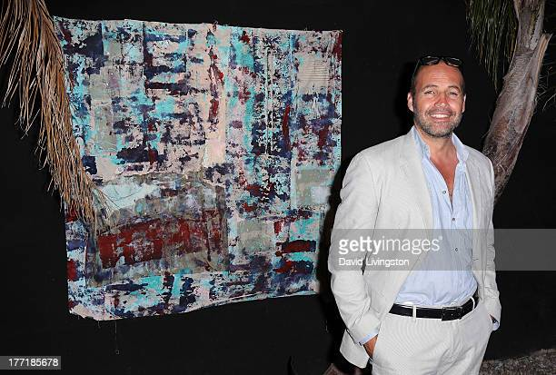 Actor Billy Zane poses with his artwork at the opening night of Billy Zane's 'Seize The Day Bed' solo art exhibition at G Gulla Jonsdottir Design on...