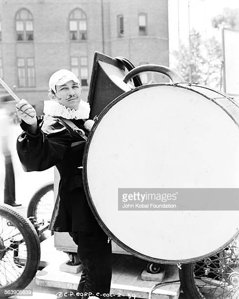 Actor Bing Crosby banging a huge drum as he films scenes for the movie 'Pennies from Heaven' for Columbia Pictures 1936