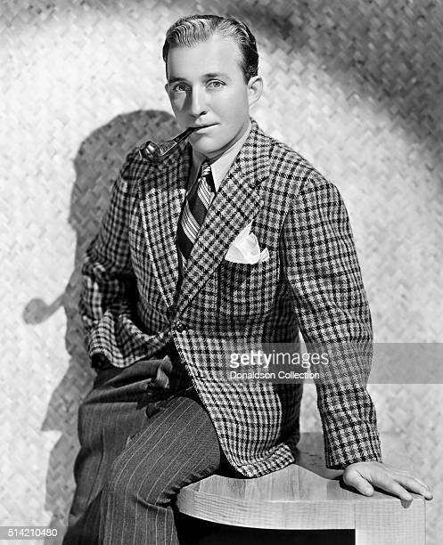 Actor Bing Crosby poses for a portrait with a pipe in circa 1938
