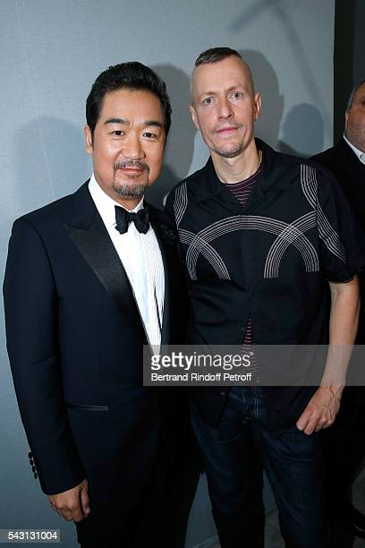 Actor Bing Hu and Stylist Lucas Ossendrijver attend the Lanvin Menswear Spring/Summer 2017 show as part of Paris Fashion Week on June 26, 2016 in...