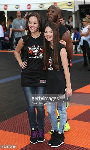 Actor BJ Britt photobombs actresses Hayley Orrantia and Landry Bender at the 3rd Annual Josh Hutcherson Celebrity Basketball Game at Nokia Plaza LA...
