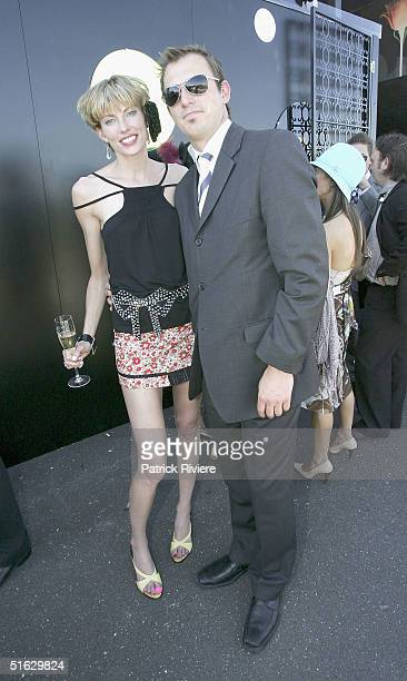 Actor Blair McDonough and Ellen Farlay attend the Melbourne Cup Carnival's Derby Day in the Moet et Chandon marquee at Flemington on October 30 2004...