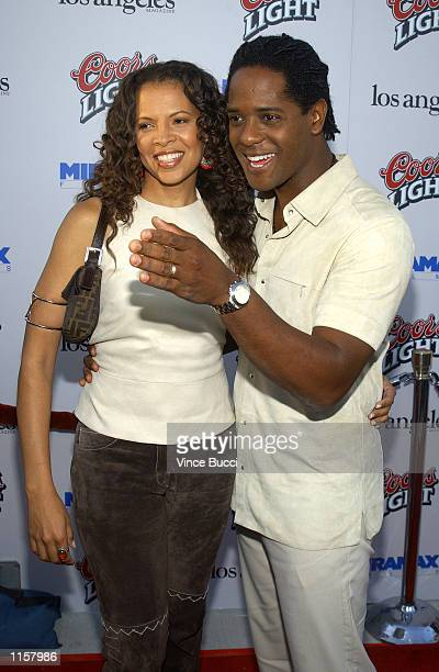 Actor Blair Underwood and wife Desiree attend the premiere of director Steven Soderbergh's new film Full Frontal on July 23 2002 in Los Angeles...