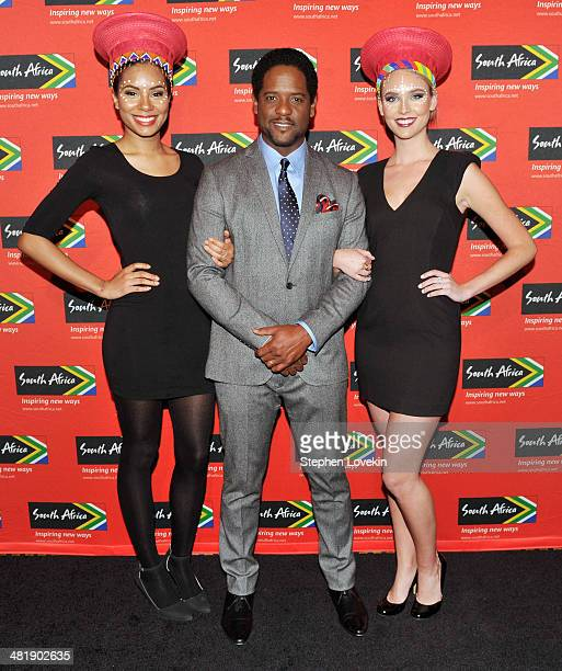 Actor Blair Underwood poses for a photo with models representing The South African Tourism Bureau at the 2014 Ubuntu Awards at Gotham Hall on April 1...
