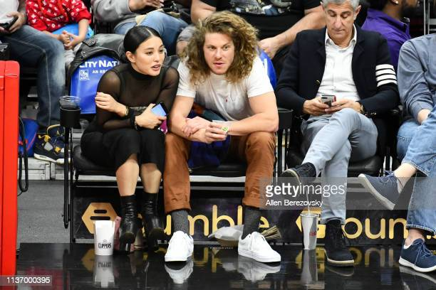 Actor Blake Anderson and a Samantha Duenas attend a basketball game between the Los Angeles Clippers and the Indiana Pacers at Staples Center on...