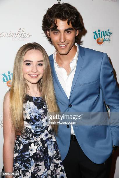 Actor Blake Michael and actress Sabrina Carpenter attend Blake Michael's 18th Birthday at Riviera 31 on August 9 2014 in Beverly Hills California