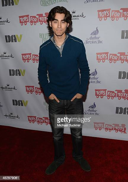 Actor Blake Michael arrives at the 82nd Annual Hollywood Christmas Parade on Hollywood Blvd on December 1 2013 in Hollywood California