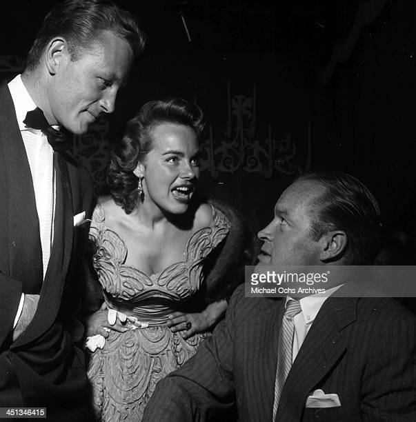 Actor Bob Hope talks with Terry Moore and Jacque Moore during a party in Los Angeles, California.
