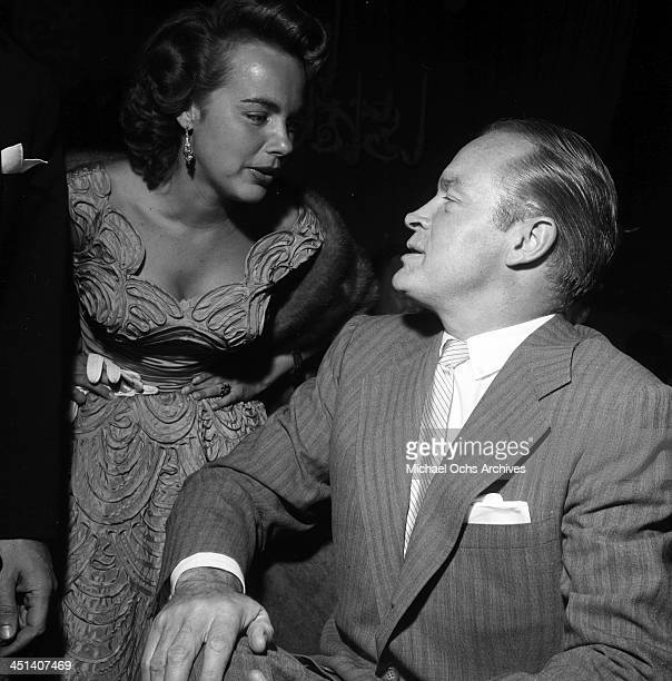 Actor Bob Hope talks with Terry Moore and Jacque Moore during a party in Los Angeles California