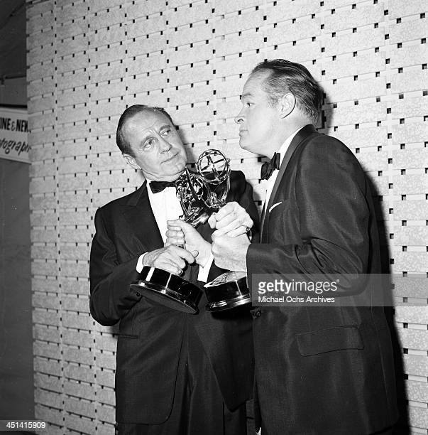 Actor Bob Hope with Jack Benny as he grabs his Golden Globe Award in Los Angeles California