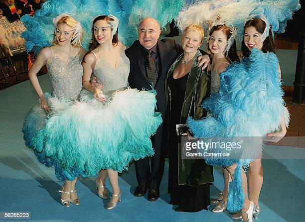Actor Bob Hoskins and Dame Judi Dench with showgirls as they arrive at the UK premiere of Mrs Henderson Presents at Vue West End on November 23 2005...