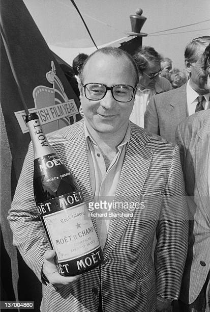 Actor Bob Hoskins holding a large bottle of Moet Chandon champagne during the British Film Year event at the Cannes Film Festival France May 1986 He...