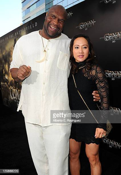Actor Bob Sapp and guest arrive at the premiere of Lionsgate Films' Conan The Barbarian on August 11 2011 in Los Angeles California