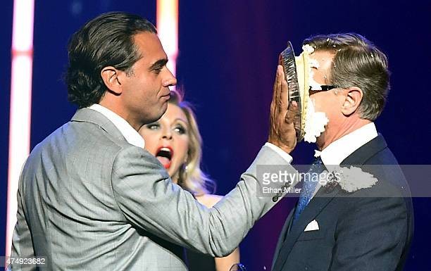 Actor Bobby Cannavale hits director Paul Feig in the face with a pie after Feig accepted the Comedy Filmmaker of the Year Award during The CinemaCon...