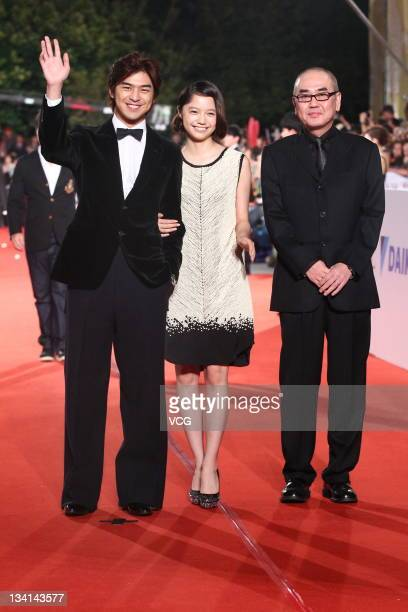 Actor Bolin Chen actress Aoi Miyazaki and director Kiyoshi Sasabe arrive at the red carpet of the 48th Golden Horse Awards at Performance Hall of...
