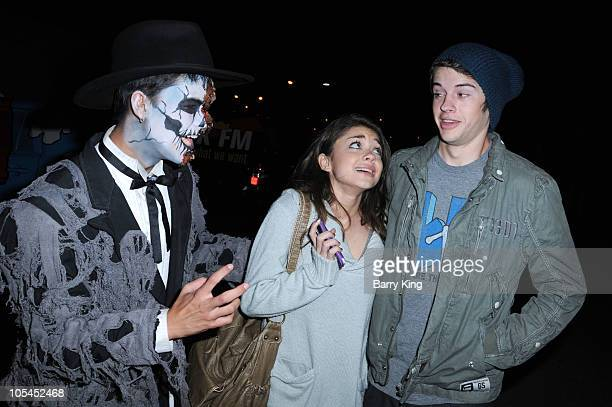 Actor BooBoo Stewart scares actress Sarah Hyland and actor Matt Prokop at Knott's Scary Farm Halloween Haunt at Knott's Berry Farm on October 13 2010...