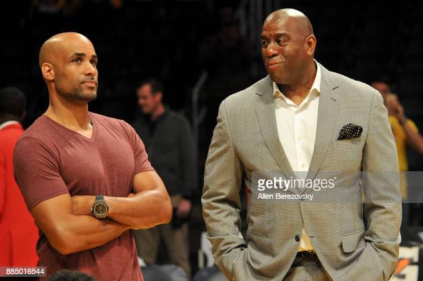Actor Boris Kodjoe and Magic Johnson attend a basketball game between the Los Angeles Lakers and the Houston Rockets at Staples Center on December 3...
