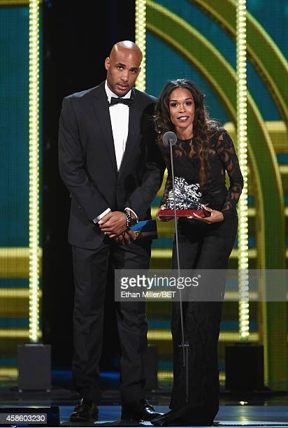 Actor Boris Kodjoe and recording artist Michelle Williams present an award onstage during the 2014 Soul Train Music Awards at the Orleans Arena on...