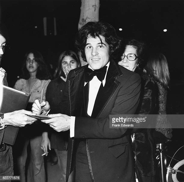 Actor Brad Davis signing autographs for fans at the People's Choice Awards Los Angeles February 1977