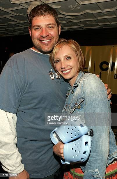 Actor Brad Henke, poses with Katelin Chesna, actress at the AVP celebration party of the launch of the AVP Crocs Tour, held at the House of Blues on...