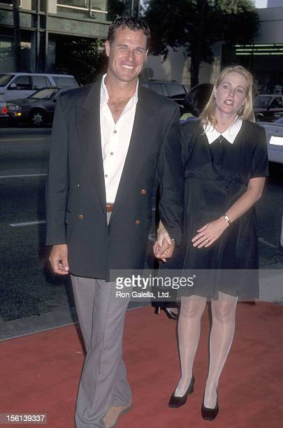 Actor Brad Johnson and wife Laurie Johnson attend the Screening of the TNT Original Movie 'Rough Riders' on July 17 1997 at Academy Theatre in...
