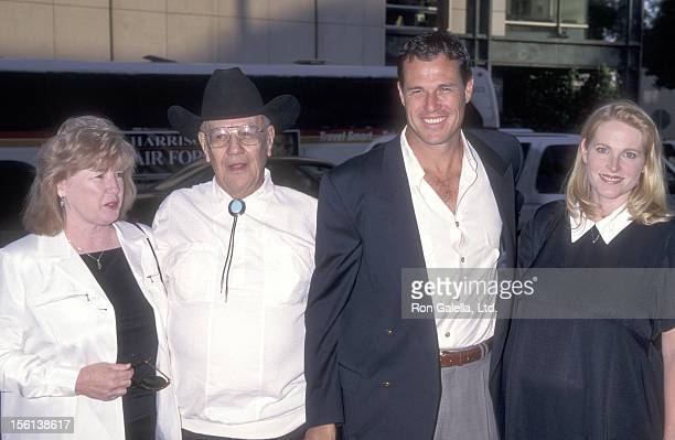 Actor Brad Johnson wife Laurie Johnson and parents Grove Johnson and Teresa Johnson attend the Screening of the TNT Original Movie 'Rough Riders' on...
