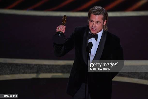 TOPSHOT US actor Brad Pitt accepts the award for Best Actor in a Supporting Role for Once upon a Timein Hollywood during the 92nd Oscars at the Dolby...
