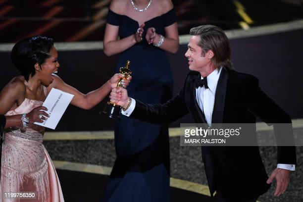 US actor Brad Pitt accepts the award for Best Actor in a Supporting Role for Once upon a Timein Hollywood from US actress Regina King during the 92nd...