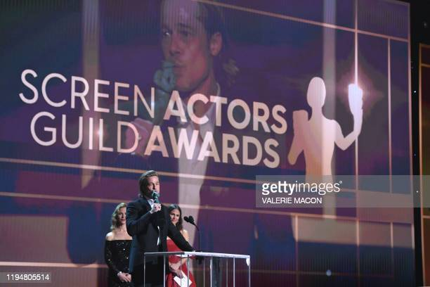 US actor Brad Pitt accepts the award for Outstanding Performance by a Male Actor in a Supporting Role during the 26th Annual Screen Actors Guild...